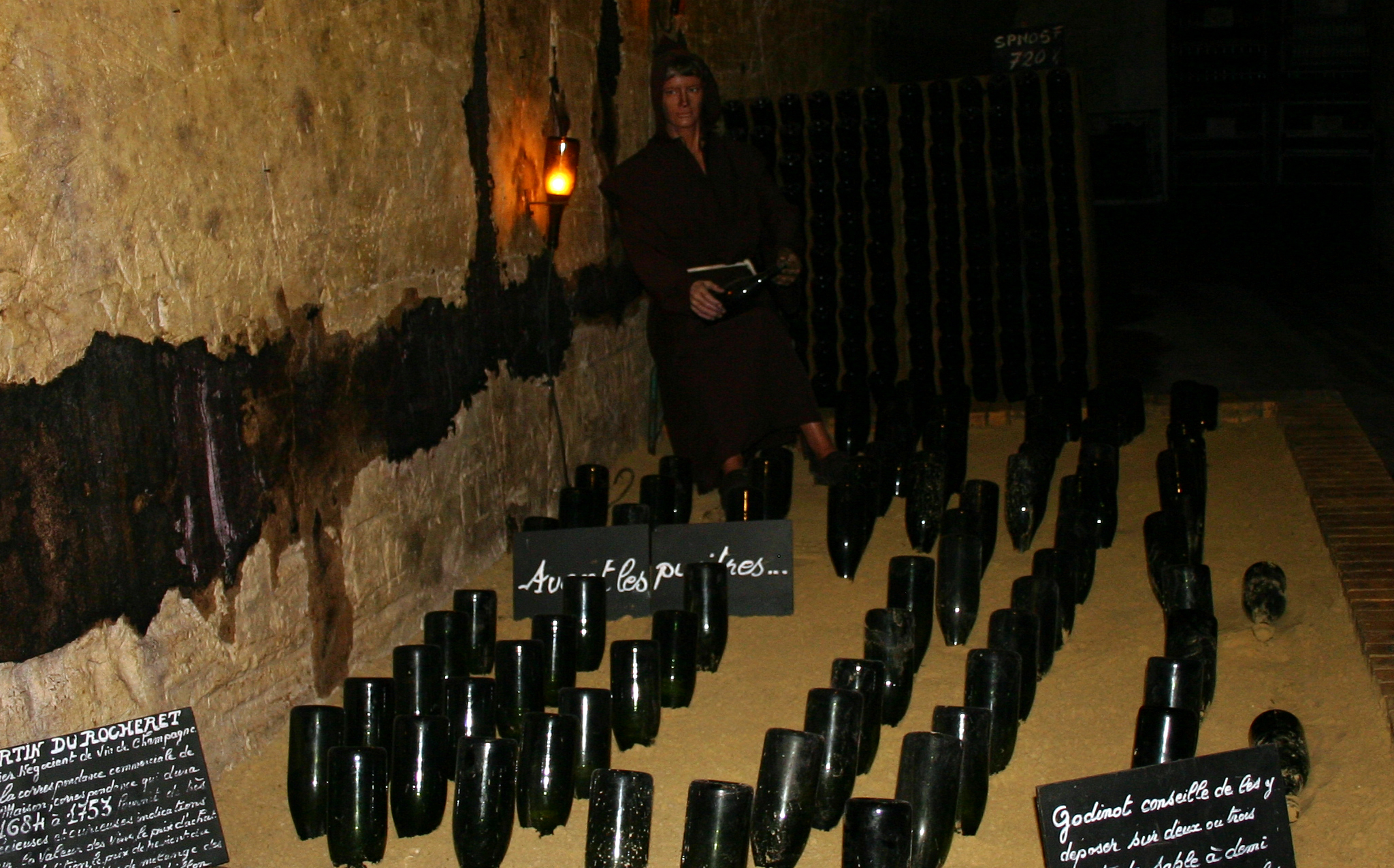 A Monk Mannequin - illustrating the first method for riddling (turning the bottles)
