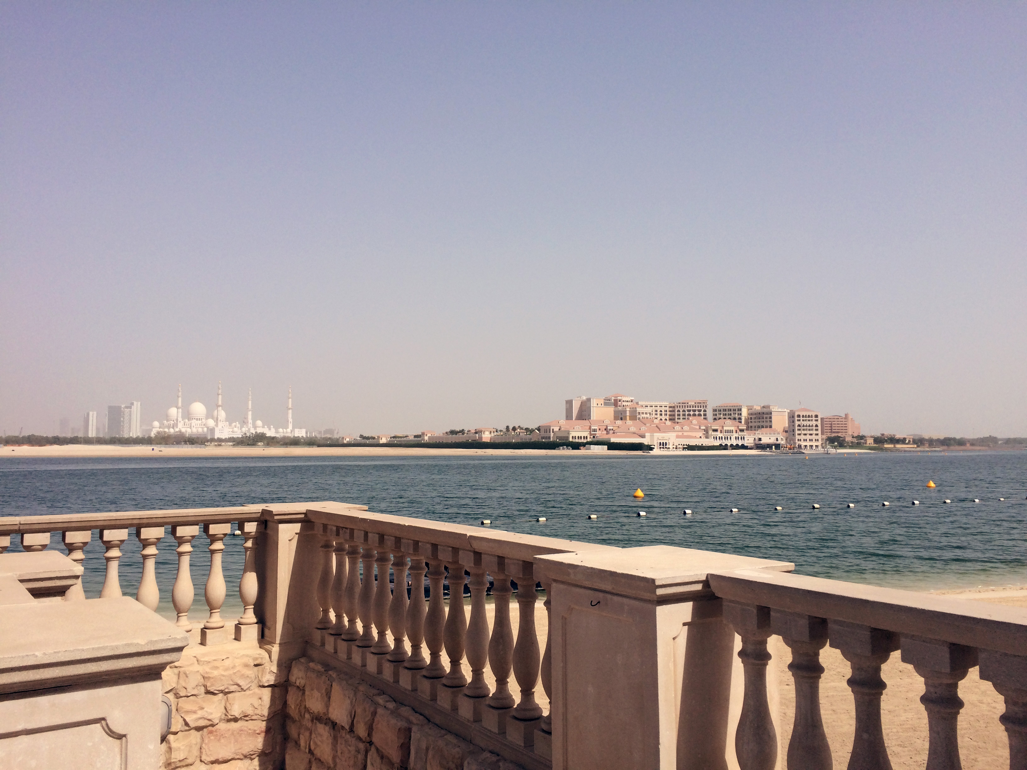View across the water to the Sheikh Zayed Grand Mosque