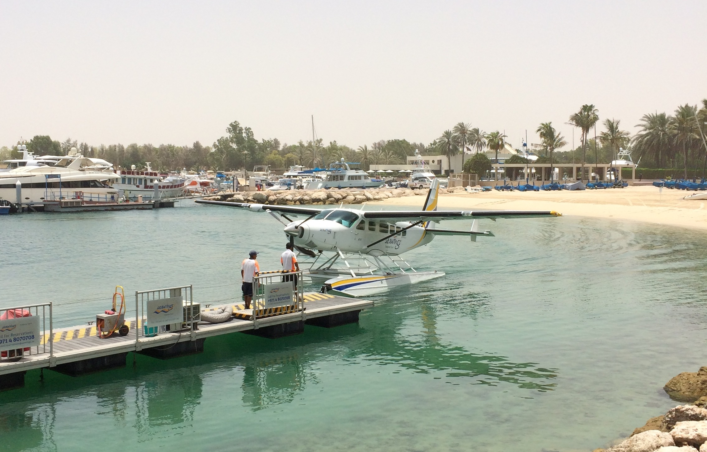 The Jetty watching the seaplane taxi in
