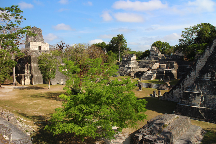 The view of Temple II on the left, Temple I on the right and the North Acropolis in between, Tikal
